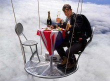 Bear Grylls toasting at 25,000 feet. Image Credit: BearGrylls.com